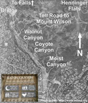 "Aerial map of Eaton Canyon and the Mount Wilson Toll Road. The canyon is the ""gash"" that runs northwest to south. To the west of the canyon is a residential area, and to the east are foothills cleft by three canyons. The horse trail is located at Walnut Canyon."